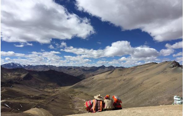 Andean villagers enjoying the view in traditional dress.