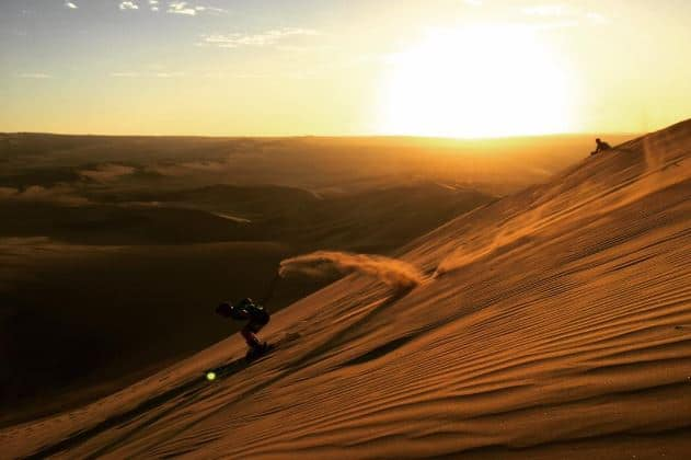 Skiing down sand dunes in Huacachina