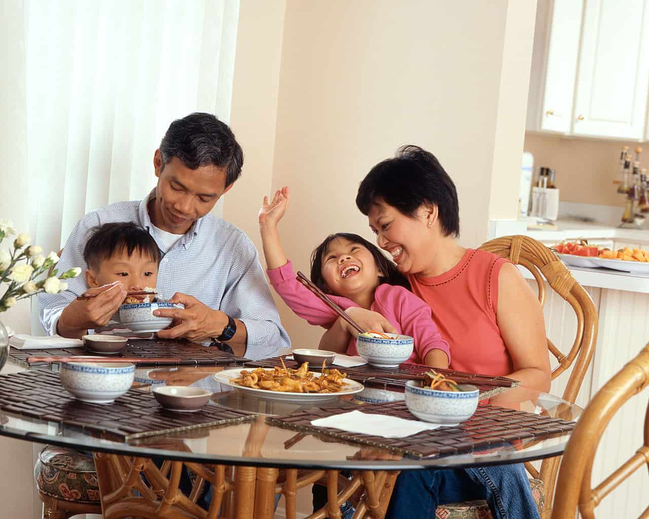 Family Eating a Meal - How to Beat the Jetlag