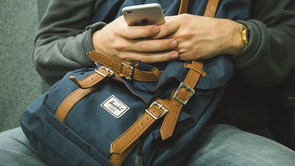 Man using smartphone - Self-Guided Adventures