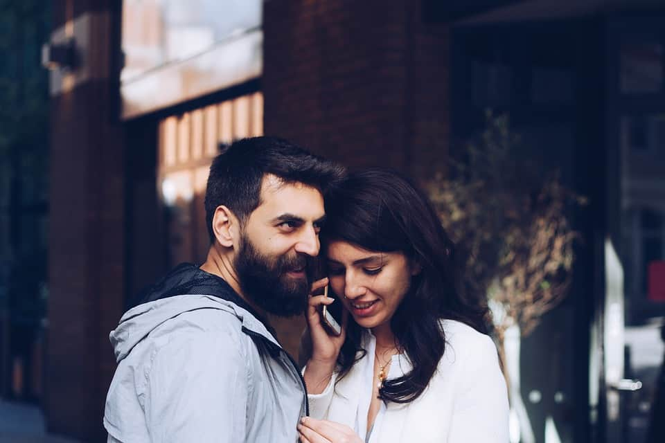 Couple talking on phone - Romance While Traveling