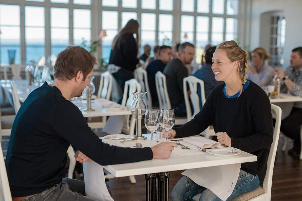 Couple in restaurant - Romance While Traveling