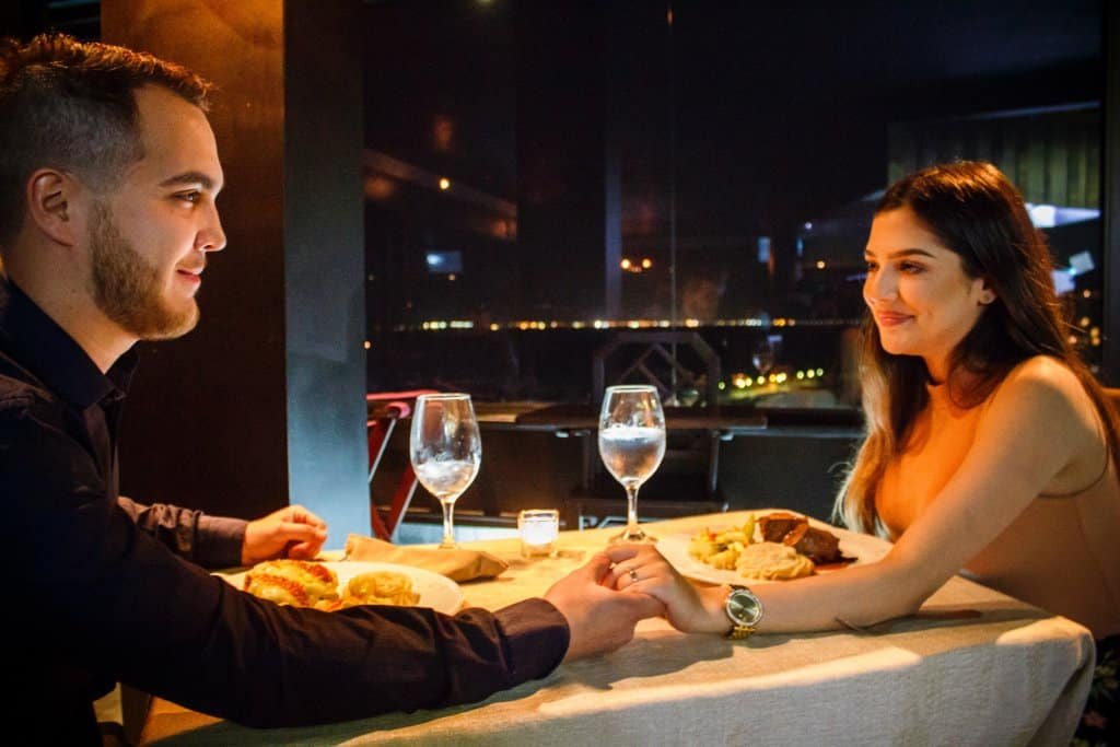Couple having dinner - Romance While Traveling