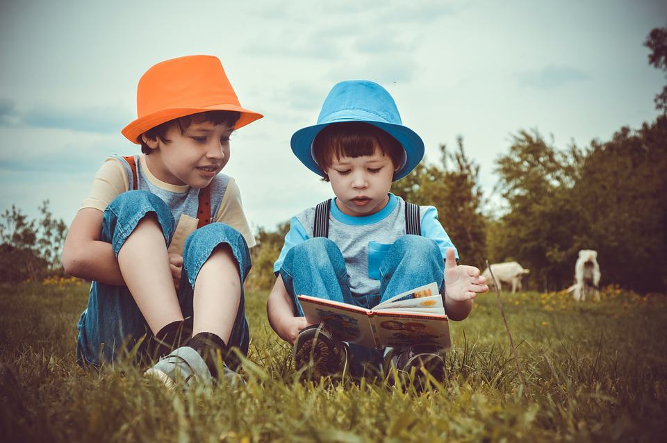 Boys reading - Why Should You Travel with Your Children